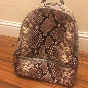 Michael Kors snakeskin print backpack bag